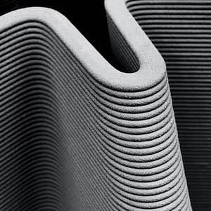 3D Drucker Material im Einsatz zum drucken eines Hausmodell.